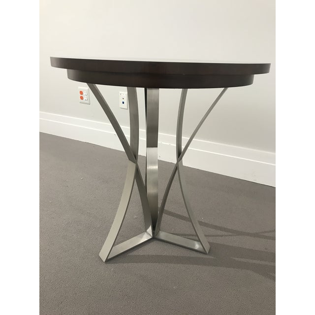 This table has a beautiful mandala design in the wood top and features a geometric style welded tripod base. The base is...