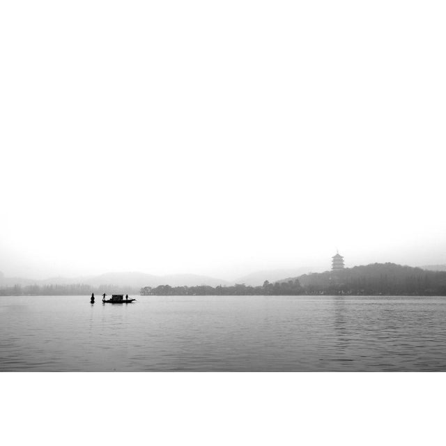This original photograph was taken in December 2012 on a foggy morning at West Tai Lake in Changzhou, China from a moving...