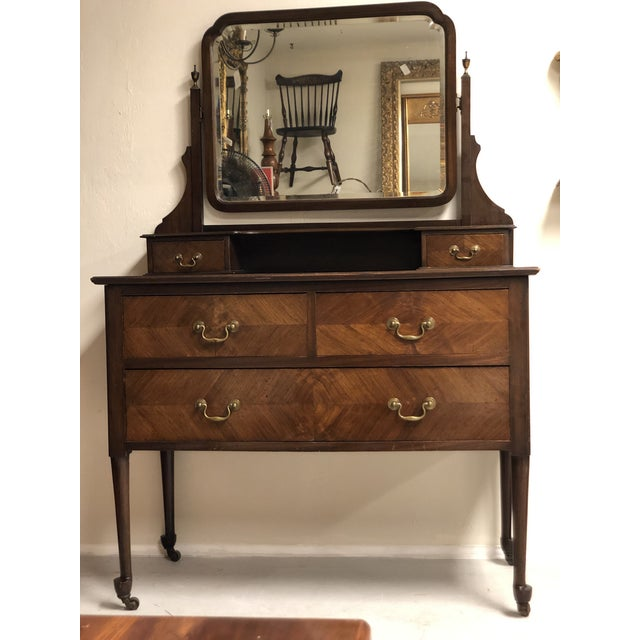 Beautiful English Mahogany Vanity with swivel mirror and contrasting drawer pattern. It would make an elegant addition to...