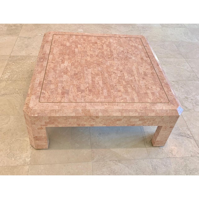 Fabulous pink Maitland Smith tessellated stone coffee table. With its unique pink color and thick square shape, this...