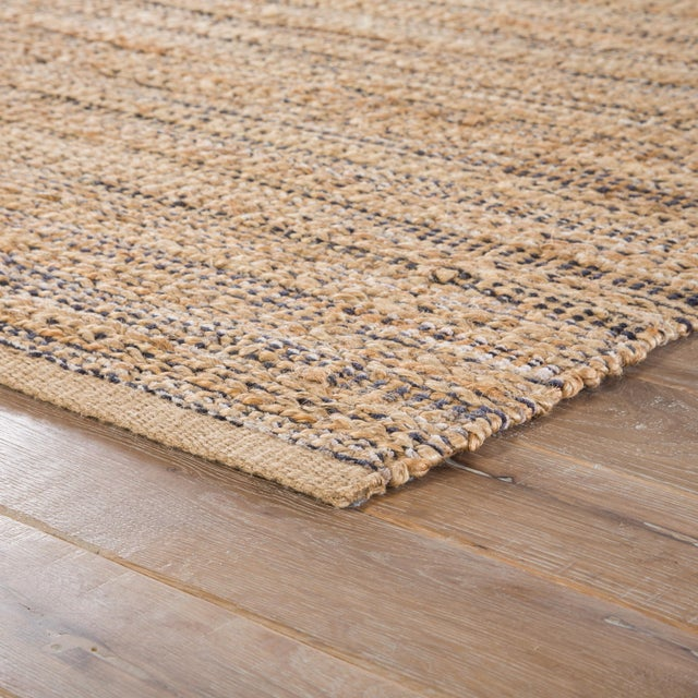 A natural area rug with a contemporary dose of color, this cotton-backed layer features mottled hints of gray and black...
