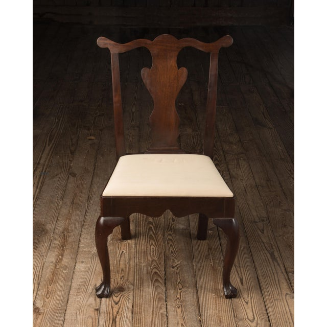 This is a vintage reproduction Chippendale solid mahogany chair. The 1990s piece was made by Madison Square Furniture, of...