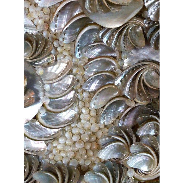 Offered for sale is an intricate and delicate mirror encrusted with Mother-of-pearl shell. Inspired by Venetian grotto...