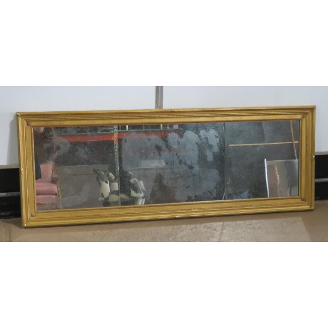 Regency style distressed 3 panel gilt framed wall mirror.