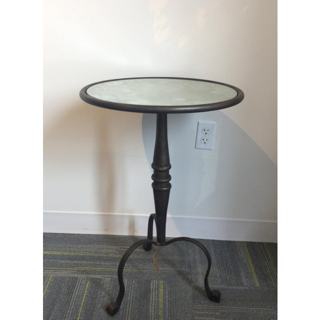 A delightful little iron side table, this piece will pair nicely with anything from a cozy leather lounge chair to a sleek...