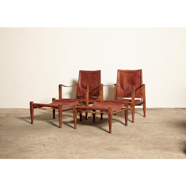 A rare and stunning pair of safari chairs and matching foot stools designed by Kaare Klint. Ashwood frame and beautifully...