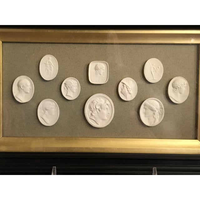 Set of 10 Antique Framed 19th Century European Grand Tour Plaster Intaglios Displayed in an antique shadowbix frame with...