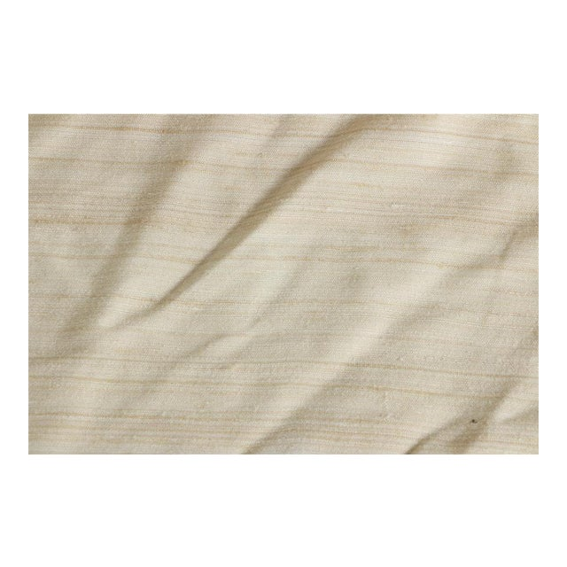 This is a beautiful bolt of raw silk fabric. Dupioni silk has a snubby texture and this is heavy for use in upholstery,...