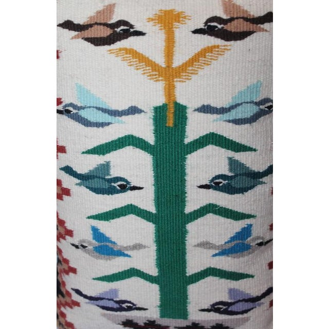 This fun pillow has different color birds and has a black cotton linen backing.