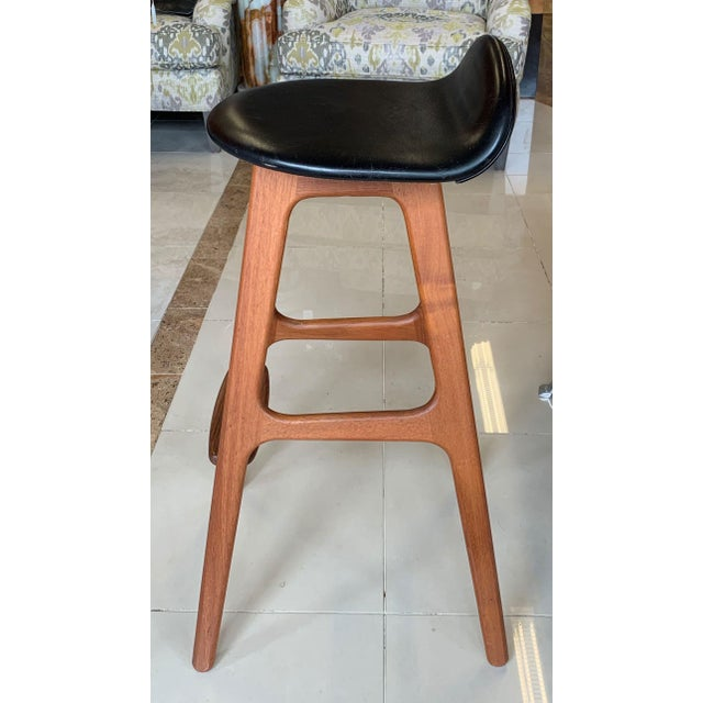 A pair of famous model OD-61 bar stools designed by Erik Buch. The beautiful ergonomic design features round seat with...