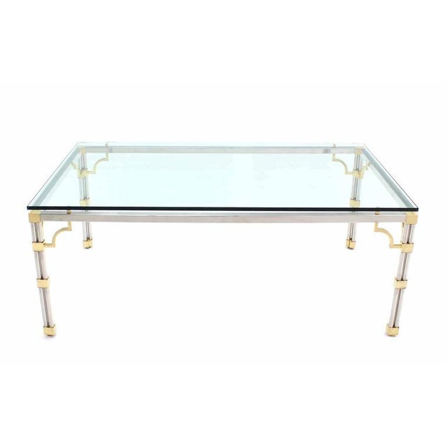 Rectangular Mid-Century Modern 3/4 inch glass top dining or conference table.