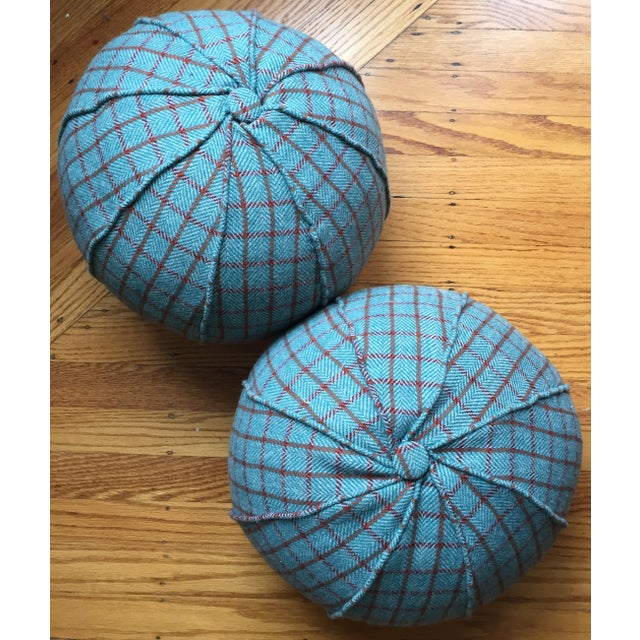 Beautiful pair of custom round pillows fabricated with a luxurious wool cloth by Holland & Sherry.