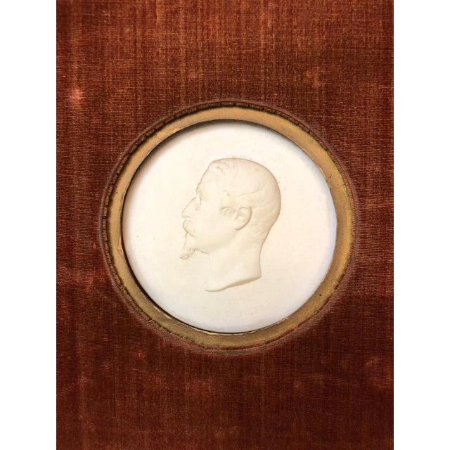 Pair of Sevres Bisque Plaques of French Emperor Napoleon III & His Wife by J. Peyre in Victorian branch carved frames with...