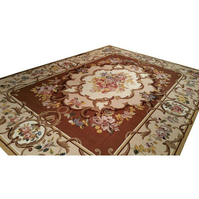 Beautiful French Style Needlepoint handmade rug 100% wool in colors of brown, beige, white, blue, yellow. This rug has a...