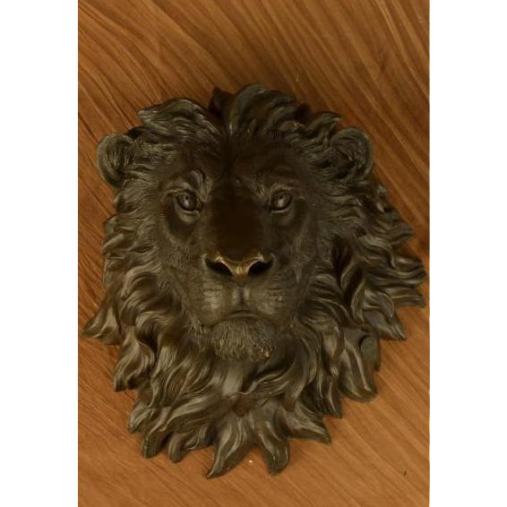 This is bronze African Lion Head wall mount, a hunter's trophy, of a magnificent creature. It's vivacity mummified for...