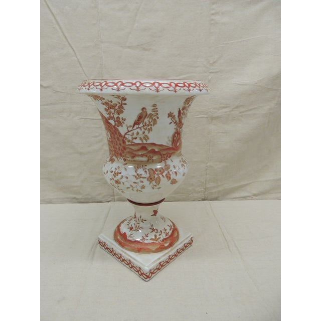 """Orange and White Ceramic Urn Depicting peacocks and trees Trellis border on the base and the top ring Size: 14"""" H x 10"""" D..."""