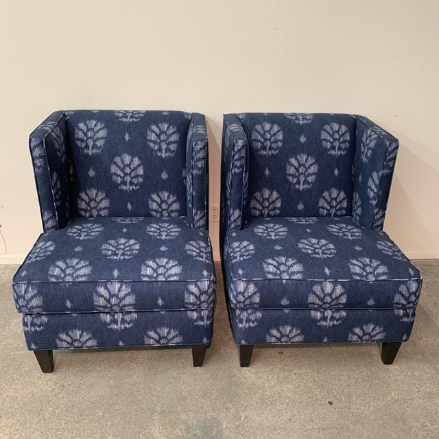 Stylish blue and white contemporary wing chairs newly recovered in a blue and white fabric. These chairs will be a great...
