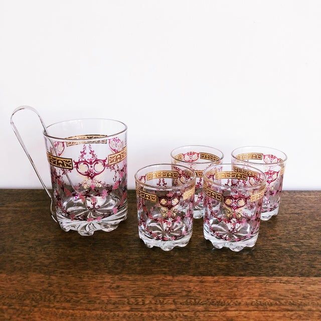 Mid-Century Italian barware set: 1 ice bucket with metal tongs and 4 lowball glasses. Pink and gold painted motifs....