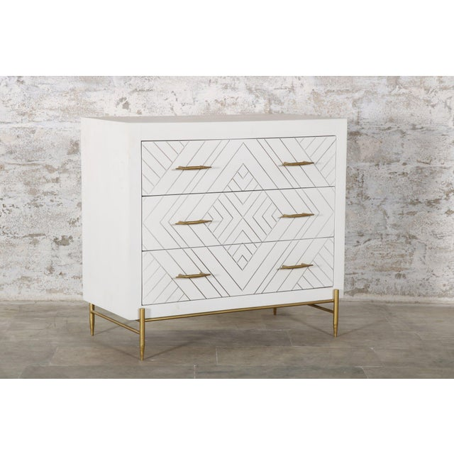 The Ava Chest catches the eye with its distinct, hand carved design. The iron legs and drawer pulls have a slightly...