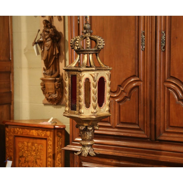 This elegant antique wall hanging lantern was carved in Italy, circa 1750. The polygonal wood lantern features a carved...