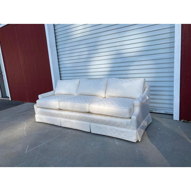 Mid Century White Tuxedo Skirted Sofa. Newly upholstered.