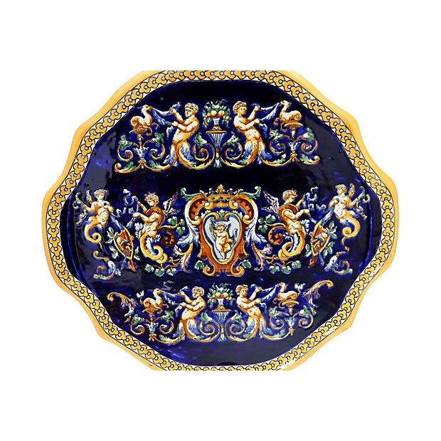 10-piece set of French Gien serving in French Renaissance pattern. Vibrant colors with deep cobalt blue background. Set...