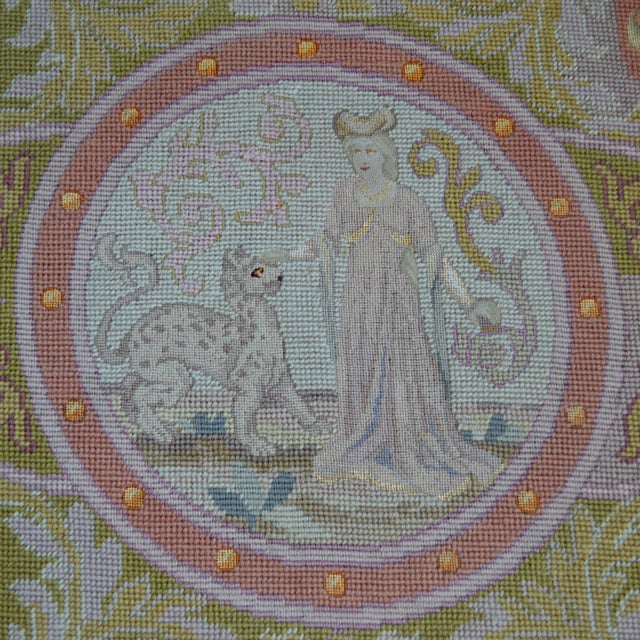 Late 19th century pale wool needlepoint panel with fine gros and petit point stitching featuring a lady and cheetah in a...