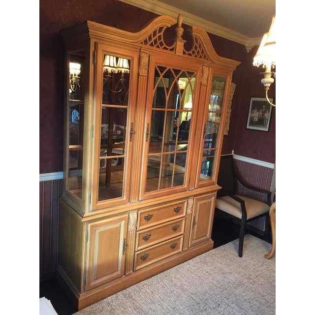 Dining hutch with glass front and sides on credenza. Top features large center door and two side doors. Two fixed...