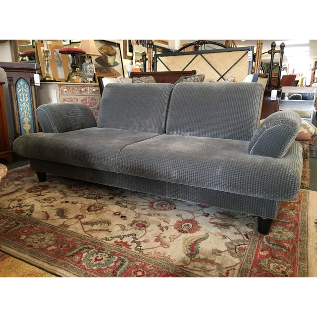 Design Plus Consignment Gallery presents a modern marvel of a sofa. Curvy, comfy arm and back rests slide easily out,...