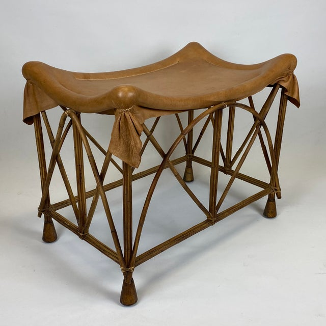 A wonderfully designed rattan stool with a soft draped leather seat!