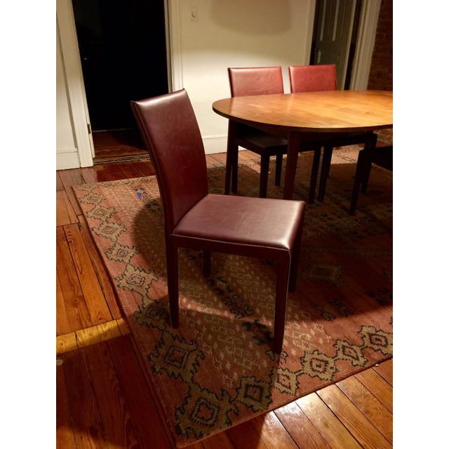 Fully wrapped in luxe leather, the chair's clean, Parsons-style lines are tailored with attention-getting details. Top-...