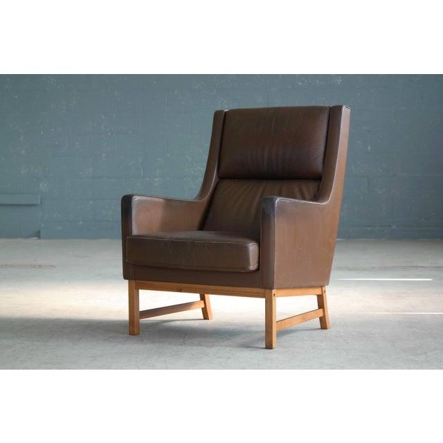 Very elegant Kai Lyngfeldt Larsen style 1960s high back lounge or armchair made in Denmark. Very similar to Larsen's well...