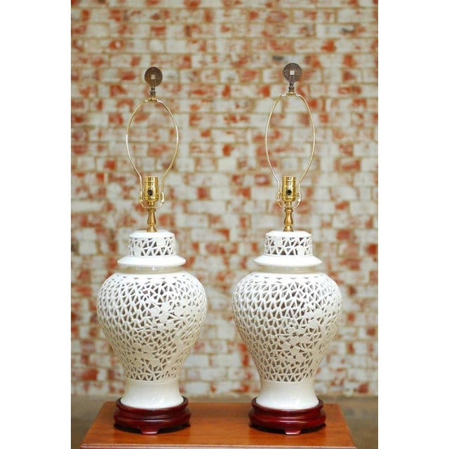 Fantastic pair of Chinese blanc de chine porcelain ginger jar form table lamps. Features a reticulated body decorated with...