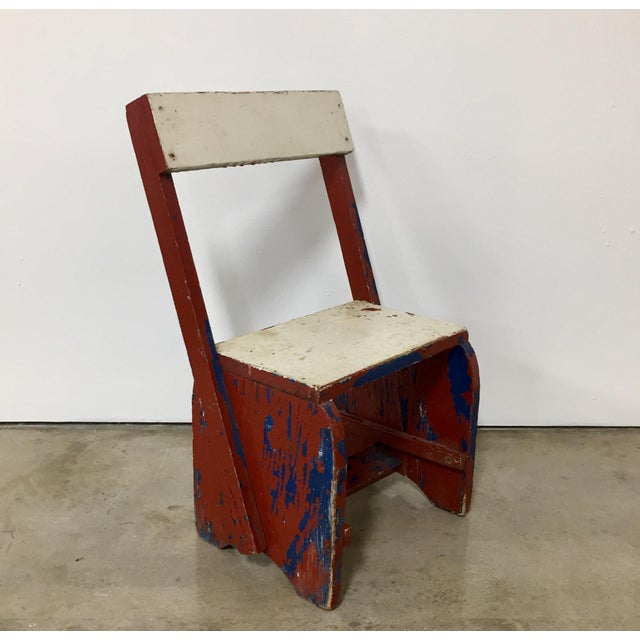 Vintage red, blue, and white child's chair with great lines and color in the De Stijl design style. The piece is from the...