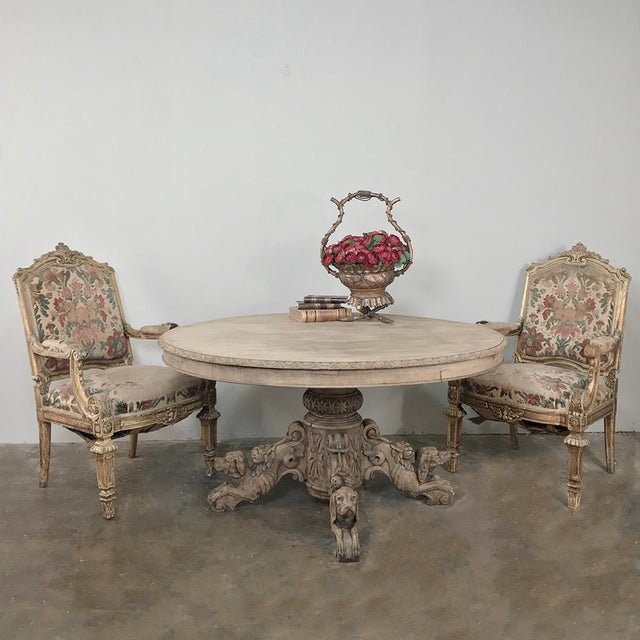 19th Century French Renaissance Stripped Oak Center Table with Hunting Dogs features a different sculpture of a hunting...