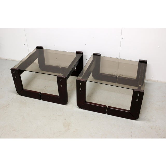 """Pair of beautiful rosewood base glass-top side tables designed by Percival Lafer. Both tables are marked """"Made in Brazil""""..."""
