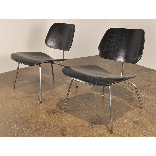 A vintage pair of ebonized Lounge Chair Metal designed by Charles and Ray Eames for Herman Miller in the 1940s. These...