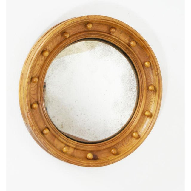 19th Century pine convex mirror. Condition: Good, with wear and shrinkage as expected.