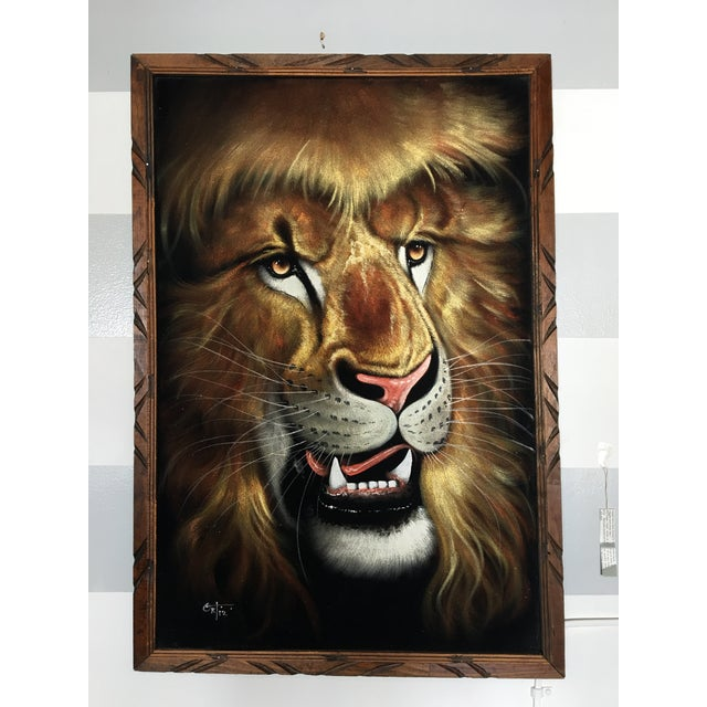 An absolutely STUNNING framed 1970's David Ortiz signed roaring lion oil painting on velvet. Stretched in a hand carved...