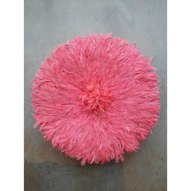 The juju hat (also known as Bamiléké feather headdress or Tyn Hat) symbolizes prosperity. It is believed to possess the...