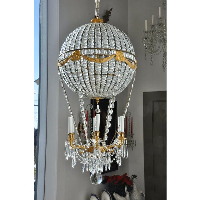 Rare and exquisite gilt bronze and crystal hot air balloon chandelier. All original and preserved. French wired arms and...