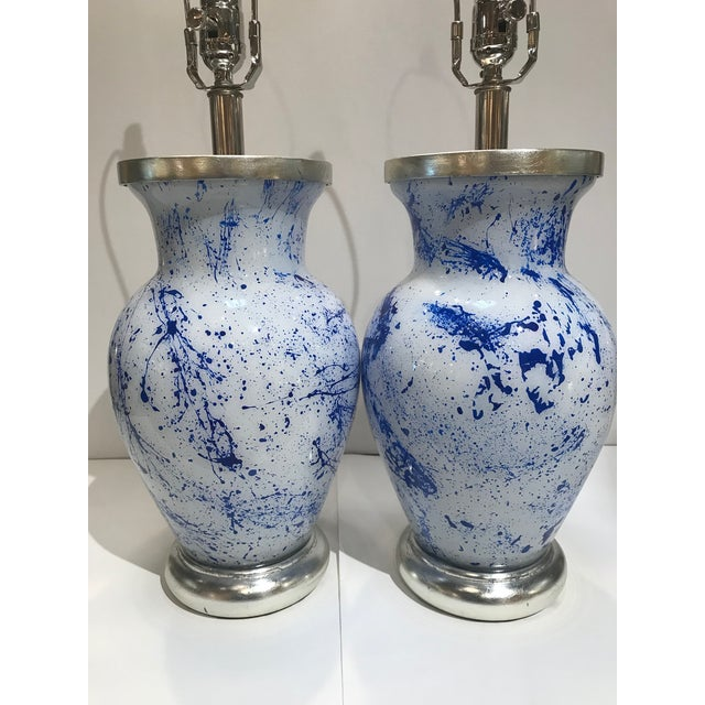 Pair of blue splatter eglomise lamps with silver gilt wood turned bases and caps and polished lacquered nickel dimmer...