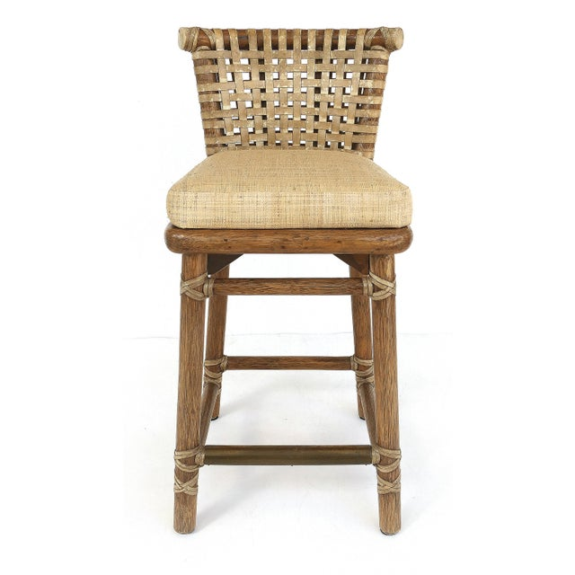 McGuire San Francisco Leather Bound Counter Stools with Raffia Upholstered Seats Offered for sale is a pair of McGuire of...
