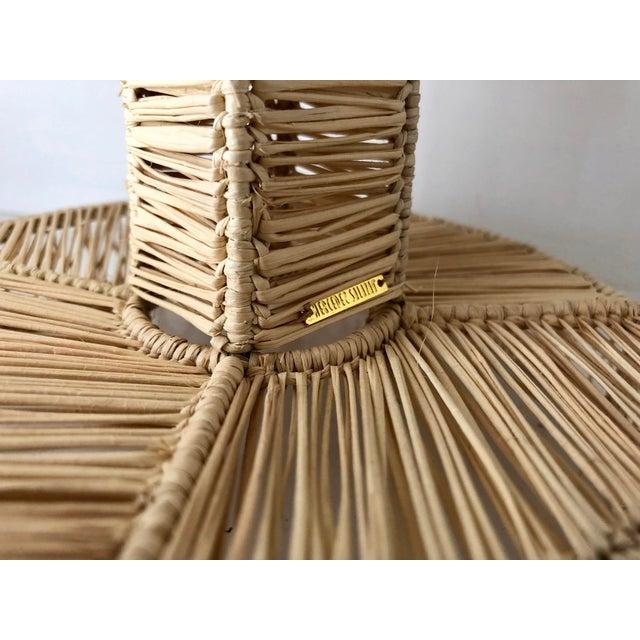 Boho chic vintage handmade floral design straw candleholder by Colombian designer Mercedes Salazar.