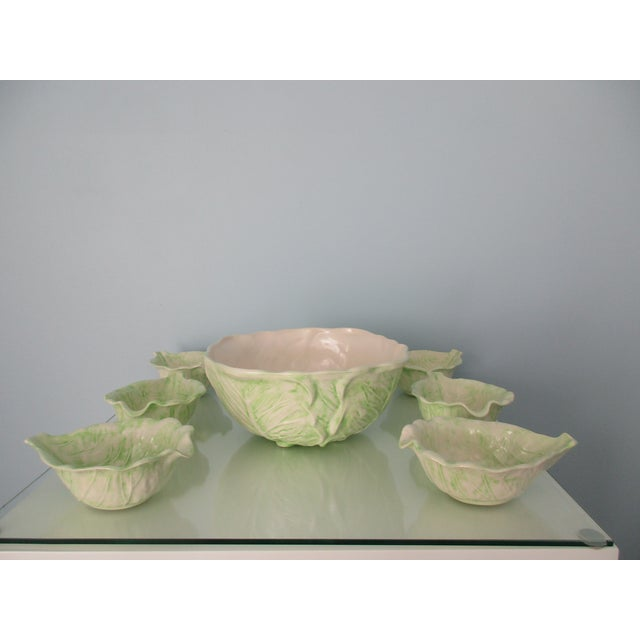 This gorgeous 7-piece set of cabbage ware is a pale green color over a white base. The set comes with one large serving...