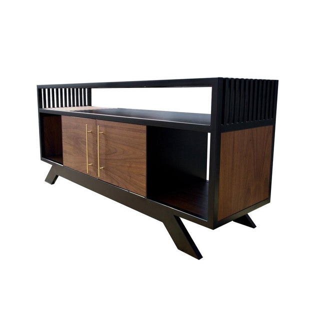 The Lloyd Credenza was created from inspiration found in mid 20th century aesthetics and the vinyl collector's storage...