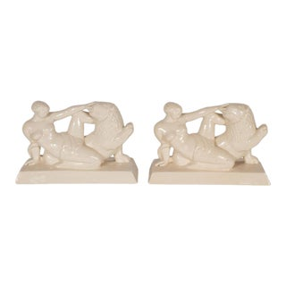 Art Deco Ceramic Book Ends Featuring Lion and Nude Female Figure For Sale