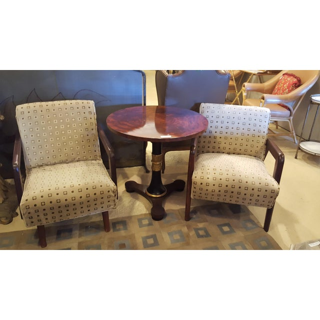 A pair of mid-century modern arm chairs. Each in a fabulous circle and square design fabric. Seat height - 16 inches