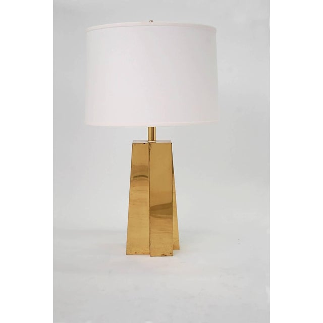 Pair of faceted brass table lamps, circa 1974. Newly re-wired. Brand new shades. Last photo shows an outline of the...