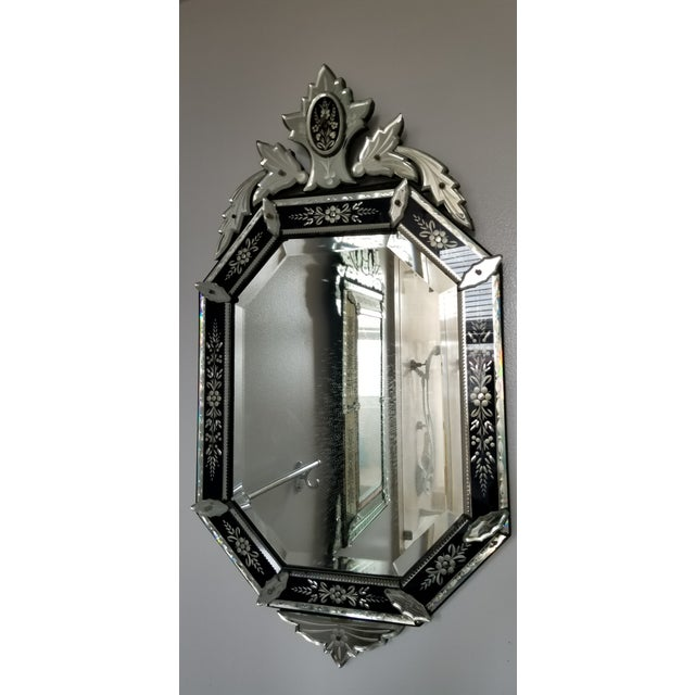 A gorgeous Italian Venitian style mirror. Rare black banding enables a more wide range possible for a modern appearance.